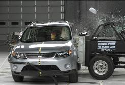 A 2008 Mitsubishi Outlander gets smacked in the Insurance Institute for Highway Safety's side crash test.