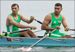 Iraq athletes Haidar Nozad, left, and Hussein Jebur compete in the men's double sculls competition. They're wearing apparel by China's Peak Group.