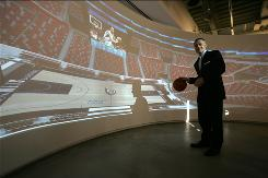 Brett Yormark, president and CEO of Nets Sports & Entertainment, stands in a mock luxury booth in his Manhattan offices used for selling arena suites.
