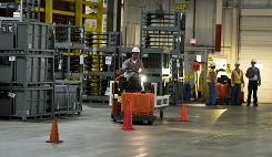 A Toyota worker is timed as he tests his skills through a slalom course in the temporarily silent Toyota Tundra Plant in San Antonio.
