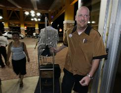 Valet Mark Thompson brings in luggage during the opening last week of the $250 million, off-Strip Eastside Cannery hotel and casino in Las Vegas.