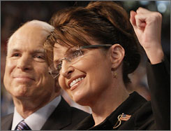 Sarah Palin, the vice presidential pick of John McCain, left, says hello to a Dayton, Ohio, crowd.