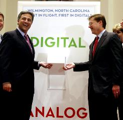 Wilmington, N.C., Mayor Bill Saffo, left, and FCC chief Kevin Martin flip a symbolic switch Monday heralding the arrival of all-digital TV in the city.