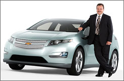 Vehicle Line Director Tony Posawatz stands next to the production version of the Chevrolet Volt.