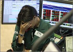 Elizabeth Rose of Lehman Bros.' MarketMakers unit reacts Monday at the New York Stock Exchange.