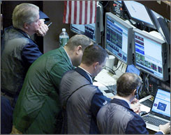 Traders on the floor of the New York Stock Exchange were encouraged by progress in the financail bailout plan but still await the details.