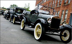 Model Ts line up Saturday for an annual parade celebrating the cars at the Ford Piquette plant, the birthplace of the iconic car, in Detroit.