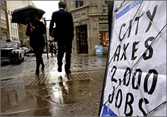 A sign displays headlines in London on Wednesday. Britain's economy over the second quarter had the weakest performance of the last 16 years.