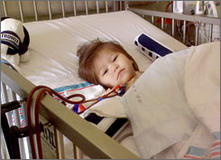 Braylee Beaver, then 19 months old, in a hospital bed during treatment for an E. coli O111 infection.