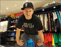 Greg Selkoe, at a Karmaloop Boston store, wearing items sold by the urban streetwear company.