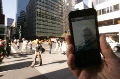 Google's G1 phone in GPS mode at the corner of 54th Street and Park Avenue in New York City. It shows a 360-degree view as you move your hand.