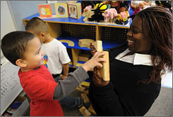 Pre-school teacher Tonya Johnson works wiht Rigoberto Torres, 4, at The Child and Family Network Centers in Alexandria, Va. The non-profit is anxiously awaiting $350,000 in funding.