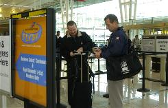 Kevin Palmer and John Hein search for their Fly By passes at the Southwest Airlines pre-security gate at Batimore-Washington International airport.