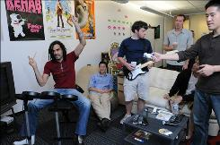 Hulu employees enjoy the Rock Band video game during a &quot;Wind Down Friday.&quot;