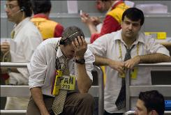 Traders work on the floor of Brazil's Mercantile and Futures Exchange in Sao Paulo on Monday.