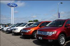 Ford SUVs are seen July 20, 2008 at a dealership in Wisconsin.