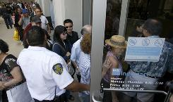 People wait to enter an IndyMac Bank in Pasadena, Calif., in July after it had been seized by regulators.