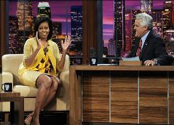 Host Jay Leno chats with Michelle Obama, wife of President-elect Barack Obama, last week.