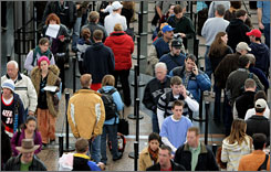 A line leads to a security checkpoint at Denver International. Nationally, passengers' average wait over Thanksgiving '07 was 11 and a half minutes.