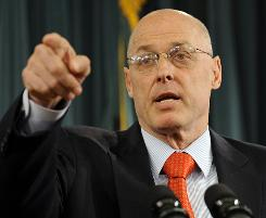 Treasury Secretary Henry Paulson calls on a reporter during his news conference at the Treasury Department.