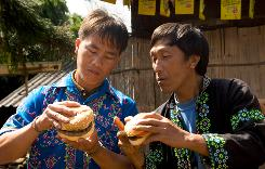 Two men in Thailand try a Whopper for the first time. The ad campaign has drawn flack from blogers accusing Burger King of trying to commercialize remote villages.