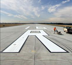 Seattle-Tacoma's new runway, its third, is 8,500 feet long and cost $1 billion to construct. Its goal is to cut down on delays during poor weather.