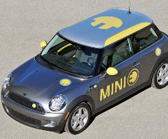BMW says its Mini E, being tested in Los Angeles and New York, goes 156 miles on a full charge.