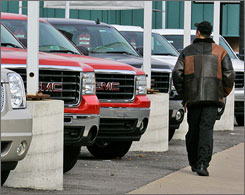 GMC SUVs sit at a dealership in Dormont, Pa., Nov. 11.