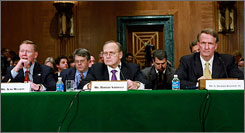 Ford Motor CEO Alan Mulally (left to right), Chrysler CEO Robert Nardelli and General Motors CEO Richard Wagoner testify at a Senate Banking, Housing and Urban Affairs Committee hearing.