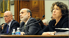 Treasury Secretary Henry Paulson (left to right), Federal Reserve Board Chairman Ben Bernanke, and Federal Deposit Insurance Corp. Chairman Sheila Bair testify before the House Financial Services Committee.
