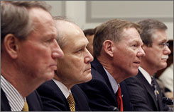 General Motors CEO Richard Wagoner (left to right); Chrysler CEO Robert Nardelli; Ford CEO Alan Mulally; and UAW President Ron Gettelfinger testify on Capitol Hill in Washington, on Wednesday.