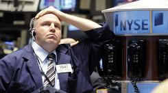 Trader Michael McCabe reacts to plunging stocks on the floor of the New York Stock Exchange on Thursday.