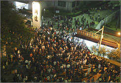 About 500 protesters rioted at a toy factory in southern China, flipping over a police car, storming the plant's gates and trashing computers over a pay dispute in Dongguan, south China's Guangdong province, Tuesday, Nov. 25, 2008.