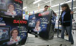 Employee German Chavez of a Wal-Mart in Secaucus, N.J, helps Nancy Ubillus with a 46-inch flat-screen TV that sells for about $800.