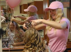 "Molly Shattuck of Baltimore, right, goes undercover in Schuylkill County, Pa., and helps a salon owner with a princess party on Fox's ""Secret Millionaire."""