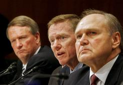 Ford Chief Executive Alan Mulally, center, flanked by General Motors Chief Executive Rick Wagoner, left, and Chrysler Chief Executive Robert Nardelli, testifies.