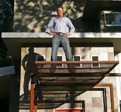 HomeAway CEO Brian Sharples stands on top of an Austin vacation property available on the company website, which is doing well despite the recession.