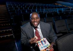 "Earvin ""Magic"" Johnson Jr. enjoys some popcorn at a Magic Johnson Theater in Harlem, N.Y. Johnson, while still a basketball player, developed the idea of opening high-quality movie theaters in inner-city neighborhoods."