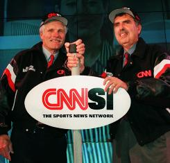 Time Warner Vice Chairman Ted Turner, left, and CEO Gerald Levin launch CNN-SI, a 24-hour sports network, in 1996. It closed down in 2002.