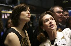 Actress Mandy Moore, left, accompanied by Noreen Culhane, of the NYSE, tours the floor of the New York Stock Exchange shortly after she rang the opening bell Friday.