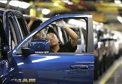 In this Sept. 12, 2008 file photo, Yolanda Germany checks the door molding on a 2009 Dodge Ram pickup being assembled at Chrysler's Warren Truck Plant in Warren, Mich.