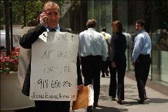 "Joshua Persky, an unemployed financial engineer, stands in front of the Charles Schwab building at 50th Street and Park Avenue with a sign proclaiming ""Experienced MIT Graduate for Hire"" this summer."