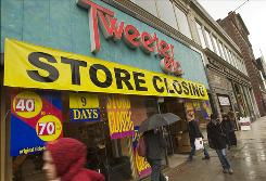 Large signs announce that this Tweeter Etc. store is closing in the Back Bay neighborhood of Boston last month.