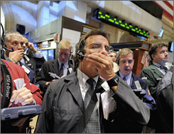 Traders react to the volatile stock market on the floor of the New York Stock Exchange floor on Oct. 6, 2008.