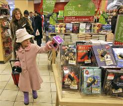 Jenna Sterling of Needham, Mass., and mother Nancy complete their holiday shopping at Borders in New York.