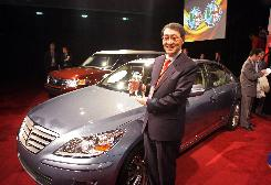 Hyun-Soon Lee, Hyundai's president of research and product development, with the Hyundai Genesis luxury sedan, which was named the 2009 North American Car of the Year.