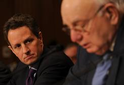 Timothy Geithner, left, listens to remarks on his behalf by Paul Volcker, former chairman of the Federal Reserve, during the hearing to consider Geithner's nomination to be secretary of the Treasury.