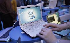 Emilie Barta of Intel demonstrates a Lenovo netbook at the Consumer Electronics Show in Las Vegas on Jan. 9.
