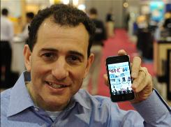 Andrew Erlichson, CEO of Phanfare, sees the Apple smartphone as &quot;the beginning of what we believe will be a convergence between smartphones and point-and-shoot cameras.&quot;
