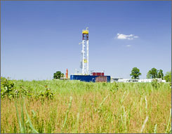 "A Southwestern Energy drilling rig in Cleburne County, Ark., targets a natural gas reservoir called the Fayetteville Shale. Southwestern Energy CEO Harold Korell attributes some of Southwestern's performance to finding gas deposits in Arkansas when ""nobody else in the world figured it out."""
